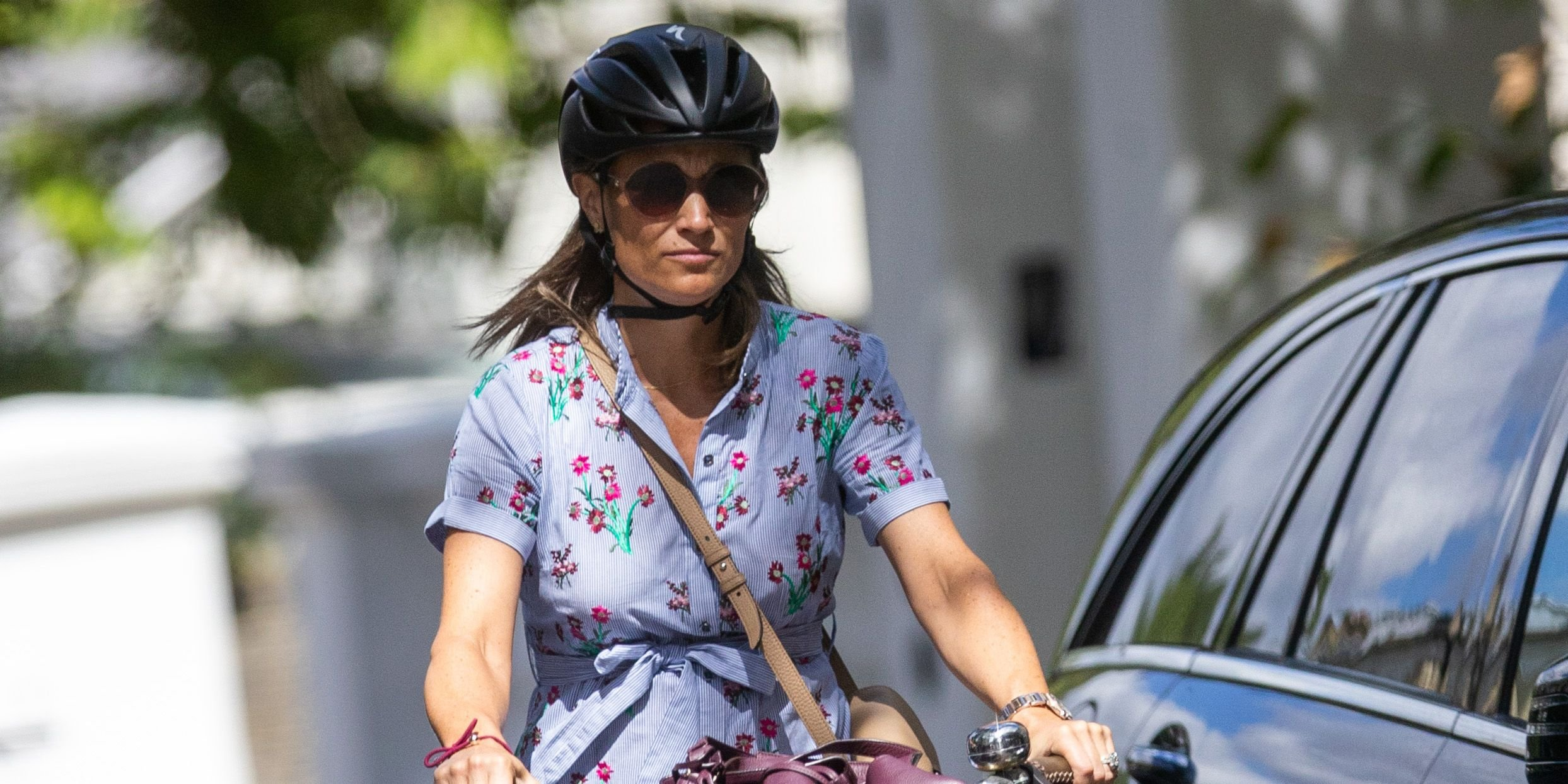 4158f758a4 Pippa Middleton Wraps Up Her Baby Bump in Florals for a Bike Ride ...